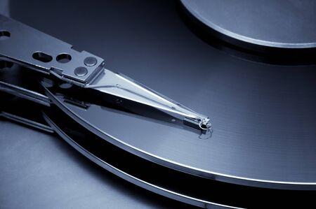 harddisk: Vintage hard disk detail. Blue toned image