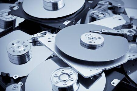 Open hard drives in bulk. Blue toned image