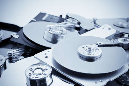 stell: Open hard drives in bulk. Blue toned image Stock Photo