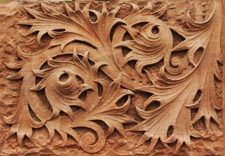 wall textures: Close-up image of ornate stone carving on building facade.