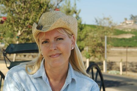 Cute Cowgirl Wearing in Country wearing cowboy hat. Stock Photo - 1311474