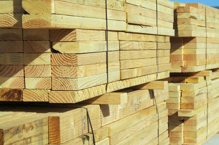 Stack of construction wood in a new residential community. Stock Photo - 1391190