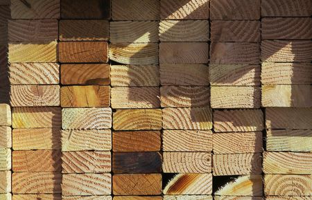 housing lot: Stack of construction wood in a new residential community.