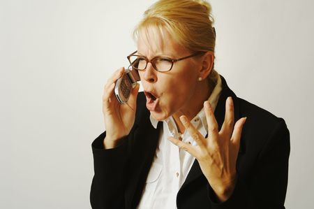 expresses: Business woman expresses her anger while on her cell phone.