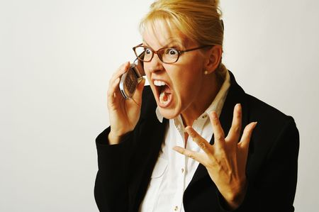 Business woman expresses her anger while on her cell phone. photo