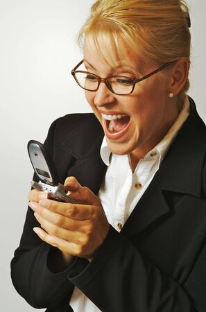mobilephones: Elated Businesswoman Using Cell Phone