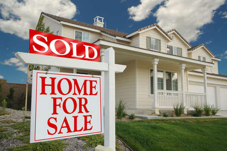 Sold Home For Sale Sign in front of Beautiful New Home. Stock Photo - 1385239
