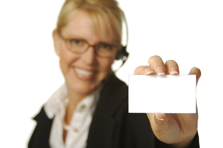 A beautiful friendly secretarytelephone operator holding a blank card ready for your message. photo