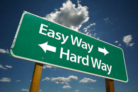 Easy Way, Hard Way Road Sign with dramatic clouds and sky. Versatile image. photo
