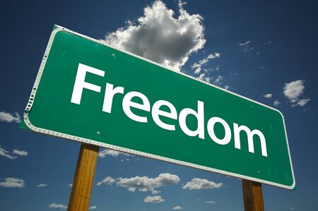Freedom Road Sign with dramatic clouds and sky. Versatile image. Stock Photo - 1479765