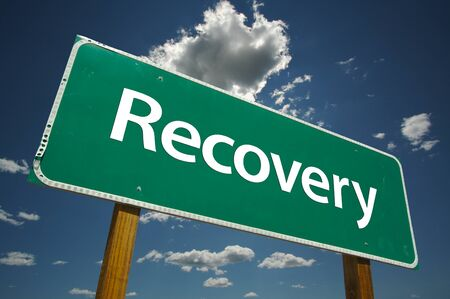 road to recovery: Recovery Road Sign with dramatic clouds and sky. Versatile image. Stock Photo
