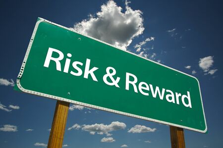 Risk & Reward Road Sign with dramatic clouds and sky. Versatile image. Stock Photo - 1479834