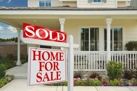 Sold Home For Sale Sign in front of Beautiful New Home. Stock Photo - 1479753
