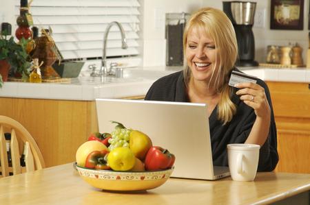 Beautiful Woman using laptop for ecommerce. Stock Photo - 1479751