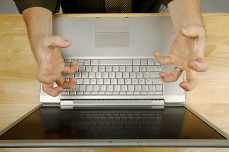 Frustrated businessman shows his frustration while working on his laptop. Stock Photo - 1489339