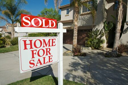 Sold Home For Sale Sign in front of Beautiful New Home. Stock Photo - 1504992