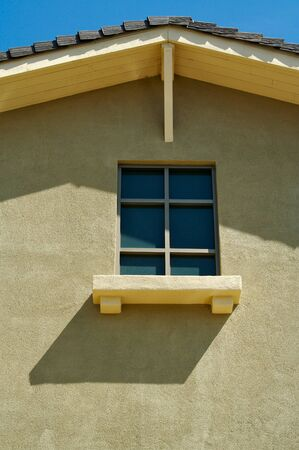 Abstract of New Stucco Wall Construction & Window photo