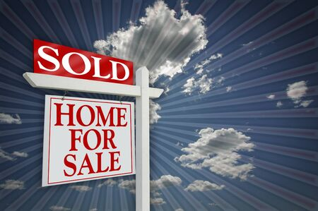 Sold Home For Sale sign on Sky & Burst Background - Ready for your own message to the right. photo