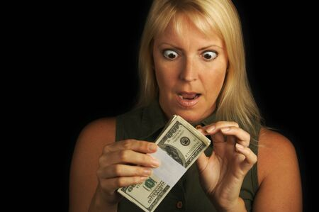 Attractive Woman Excited About her Stack of Money on a Black Background Stock Photo - 1525784