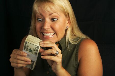 Attractive Woman Excited About her Stack of Money on a Black Background Stock Photo - 1525793
