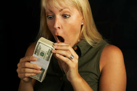 Attractive Woman Excited About her Stack of Money on a Black Background Stock Photo - 1525792