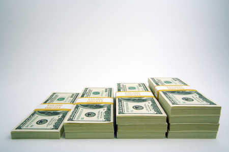 Stacks of One Hundred Dollar Bills on a white background. photo