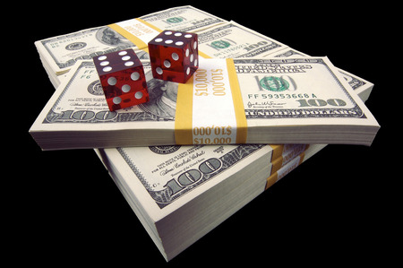 enrich: Stacks of Ten Thousand Dollar Piles of One Hundred Dollar Bills & Dice on a black background.
