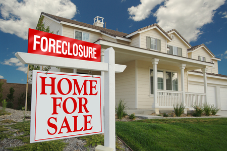 foreclosure: Foreclosure Home For Sale Sign and House with dramatic sky background.