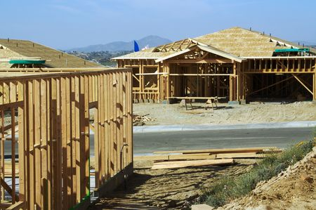 housing lot: Construction site with new home framing.