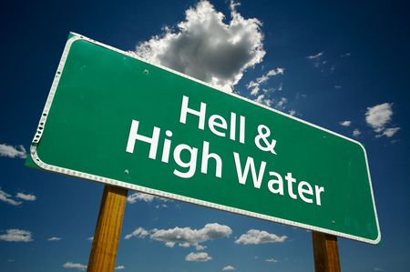 permanence: Hell & High Water Road Sign with dramatic blue sky and clouds. Stock Photo