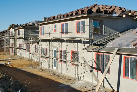 housing lot: New Home Construction Site with freshly plastered walls and tiles ready for installation. Stock Photo
