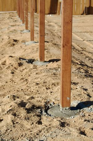 installed: Freshly Installed Fence Posts. Stock Photo