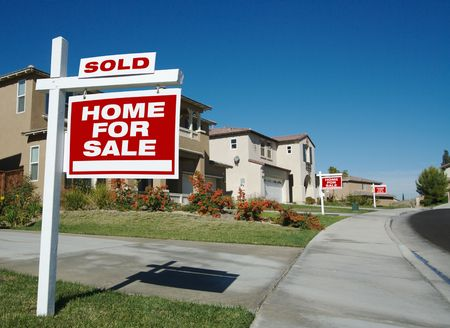 Home For Sale Signs & One Sold in Front of New Homes Stock Photo - 1950730