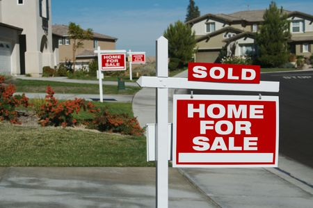 Home For Sale Signs & One Sold in Front of New Homes Stock Photo - 1950729