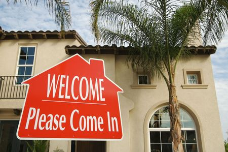 come in: Welcome, Please Come In Real Estate Sign with new home in the background.