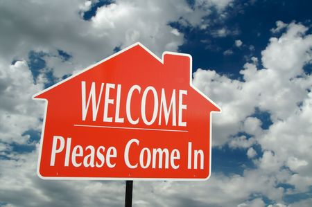 come in: Welcome, Please Come In Real Estate Sign with clouds in the background.