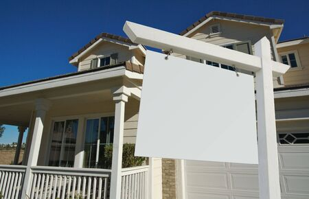 Blank Real Estate Sign and House with dramatic sky background. Ready for your own message. Stock Photo - 2094913