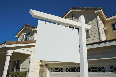 Blank Real Estate Sign and House with dramatic sky background. Ready for your own message.