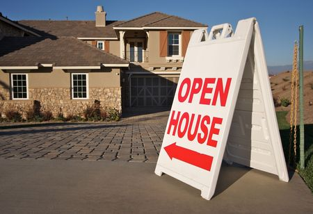 open house: Open House Sign in Front of A Brand New Home. Room for your own message at the top of the sign. Stock Photo