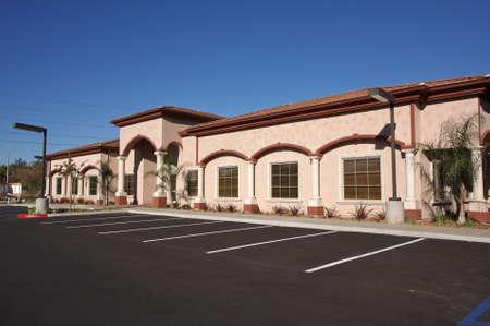 vago: New Vacant Retail Building Parking Spaces.