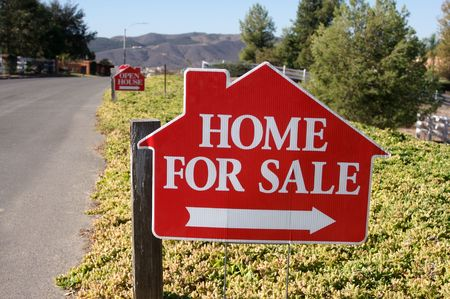 in escrow: Home For Sale Sign along a rural street. Stock Photo