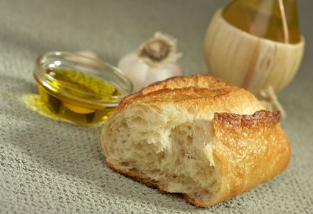 Sourdough Bread, Olive Oil and Garlic with Narrow Depth of Field Stock Photo