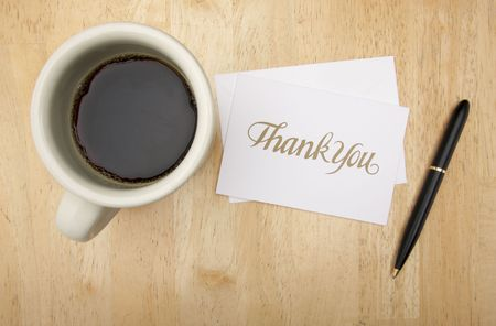 Thank You Note Card, Pen and Coffee Cup on Wood Background photo