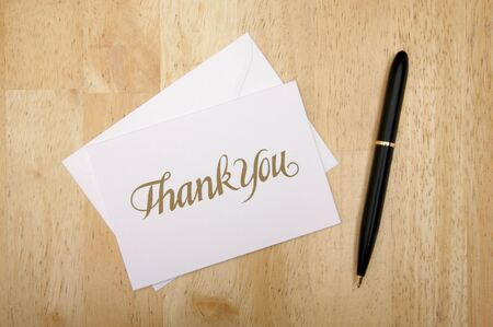 respond: Thank You Note Card and Pen on Wood Background Stock Photo