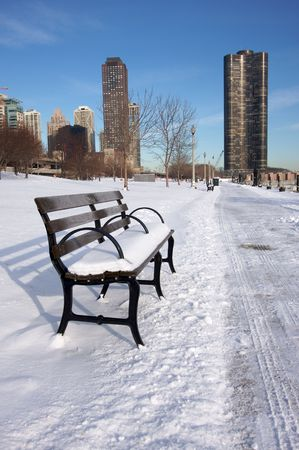 Empty Snowy Bench in Chicago After Winter Snow Along Lake Shore Drive. photo