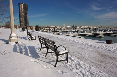 lake shore drive: Empty Snowy Bench in Chicago After Winter Snow Along Lake Shore Drive.