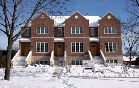 townhome: Modern Townhome Facade on a Snowy Winter Day