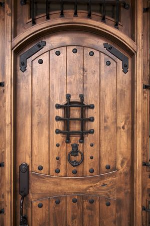 A newly constructed, modern American home wooden doorway. photo