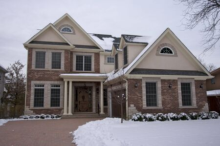 Majestic Newly Constructed Home Facade on a Blustry Winter Day photo