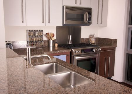 stainless: Modern Apartment Kitchen with brushed aluminum appliances. Stock Photo